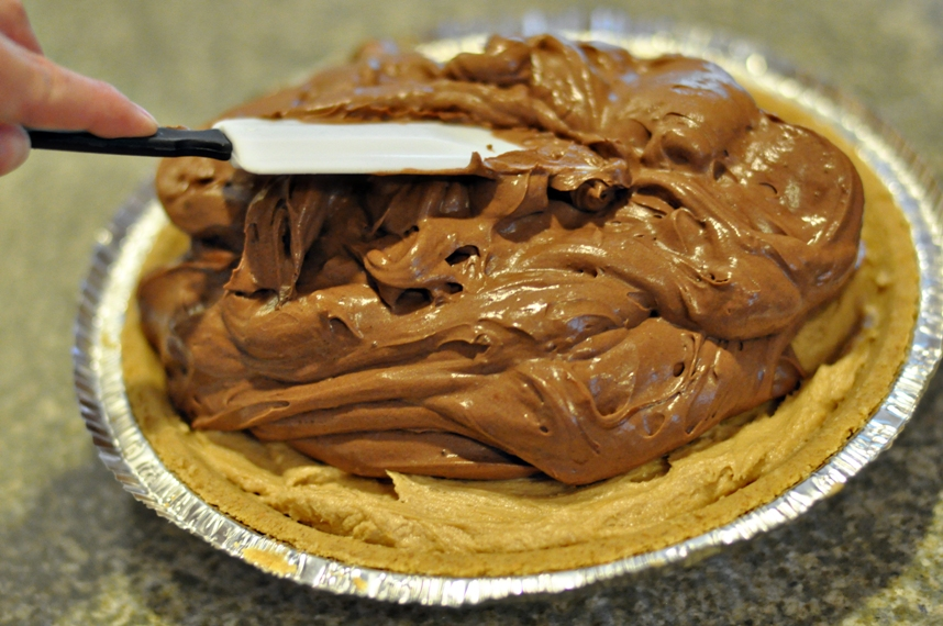 Spread chocolate mixture over peanut butter layer
