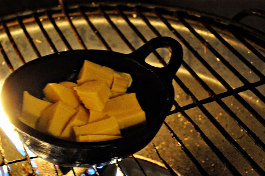 Melting queso on a charcoal grill